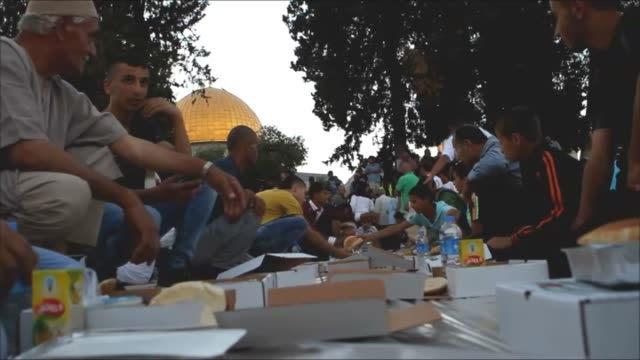 Muslims break their fast at a fastbreaking dinner during Ramadan at the AlAqsa mosque compound in the Old City of Jerusalem on June 17 2015