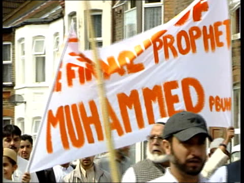 Muslims march against Islamic extremists and terrorism ENGLAND Luton Muslims marching to condemn Muslim extremists and terrorism they carry placards...