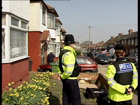 Muslims march against Islamic extremists and terrorism LIB GVS police outside houses where terror raids have taken place