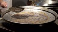 HD: Mussels frying in oil in a pan