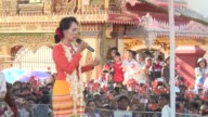 Myanmar opposition leader Aung San Suu Kyi gives a speech at the Kyaingtong township in Myanmar ahead of crunch polls