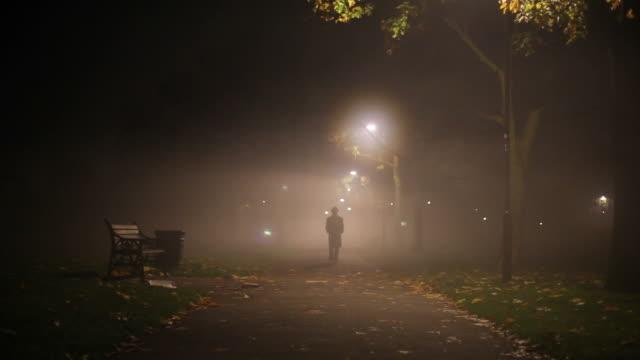 mysterious man walking in the dark
