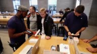 n Apple employee assists a customer who had preordered the Apple iPhone 7 on the first day of sales of the new phone at the Berlin Apple store on...