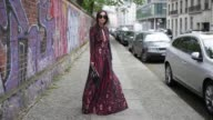Nadja Ali wearing Lala Berlin dress black Celine sunglasses Adidas sneaker black Gucci clutch with the print blind for love on May 7 2017 in Berlin...