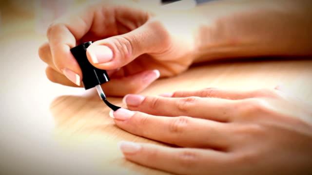 Nail polishing.