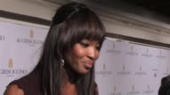 Naomi Campbell on Fashion for Relief being backstage her mother helping out at de Grisogono Party 64th Cannes Film Festival on May 17 2011 in Antibes...
