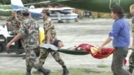 Napali Army carry an injured person at Tribhuvan International Airport in Kathmandu / A major earthquake hit Kathmandu midday on Saturday April 25th...