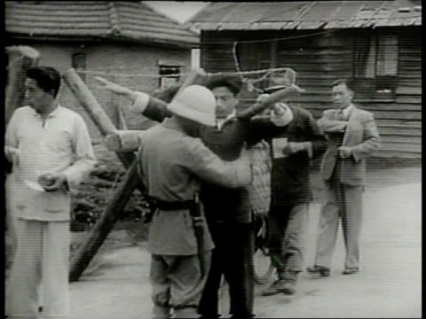 Narrated / 1949 Newsreel /People driving cars and motorcycles out of Shanghai are inspected by police / Pedestrians and bicycle riders are checked as...