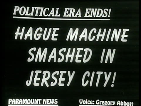 Narrated / 1949 Newsreel / The New York skyline is shadowed by fog / River view of Jersey City / Winning Mayoral candidate John Kenny sits at his...