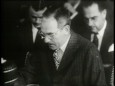 Narrated / In a court room the US Foreign Relations Committee North Atlantic Treaty / Secretary of State Dean Acheson shakes hands with Senators...