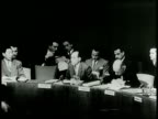 Narrated / Members of the United State Security Council sit as a round table / Many spectators watch from the general assembly / Abba Eban is shown...