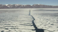 A narrow channel cuts through a field of sea ice off the coast of North Baffin Island.