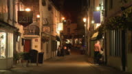 WS, Narrow street in old town illuminated at night, Windermere, Cumbria, England