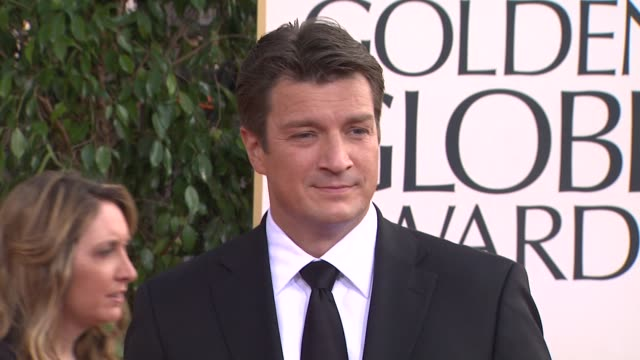 Nathan Fillion at the 70th Annual Golden Globe Awards Arrivals in Beverly Hills CA on 1/13/13