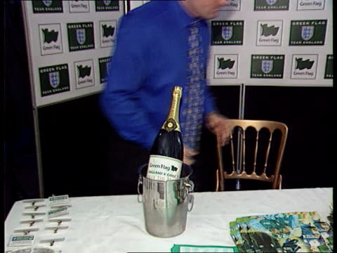 National car parks Unknown location Bottle of champagne with name of England team sponsor `Green Flag' on label in ice bucket on table