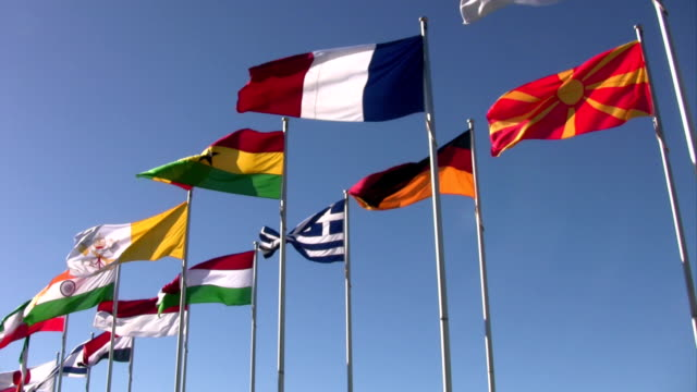 National Flags from France, Germany, Greece and more. Blue Sky.