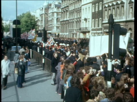 London Victoria Embankment MS Police towards and along pavement MS Police and National Front with band march along road AngleV PAN Big Ben to posters...