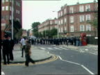 West London OUT crowd MS Police PAN another line across next street MS PAN line of police TS PAN two lines of police keeping apart National Front...