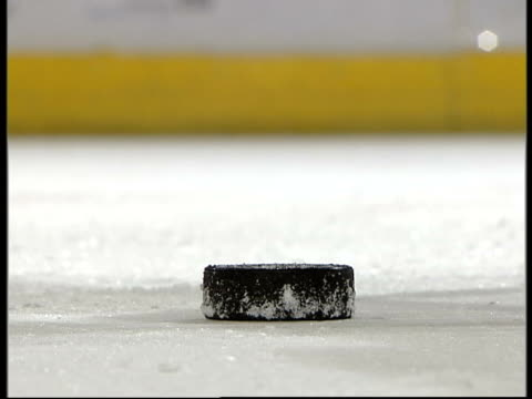 National Hockey League is cancelled for the season Location Unknown Puck being hit during ice hockey match