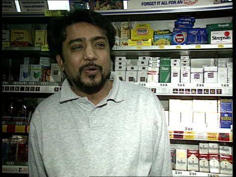 Possible 40 million pound jackpot Customer being handed slip and ticket by shopkeeper Shopkeeper interview SOT people are betting 5 to 10 pounds...
