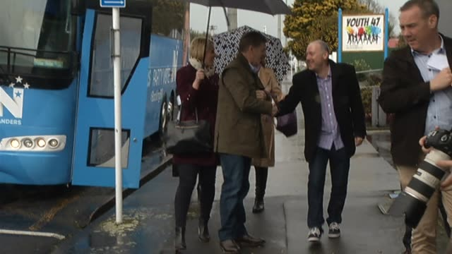 National Party leader Bill English on 2017 General Election campaign trail getting off campaign bus in town of Hawera speaking in coffee bar about...
