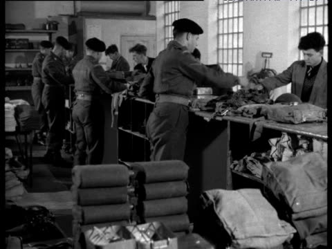 National Service soldiers are issued with kit at army barracks 1956