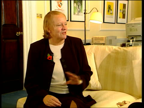 National stress awareness day INT Mo Mowlam MP interview SOT Talks of throwing stress balls at people CS Goldfish Mowlam opening cupboard door to...