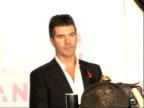 red carpet arrivals and backstage Simon Cowell photocall holding award accompanied by Andrew Lloyd Webber/ Simon Cowell answering journalists'...
