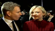 Red carpet arrivals and interviews / Winners room photocalls and interviews Patrick Kielty and Fearne Cotton wearing red and black patterned dress...
