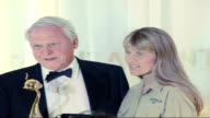 Red carpet arrivals and interviews / Winners room photocalls and interviews Sir David Attenborough and Terri Irwin wearing khaki shirt and trousers...