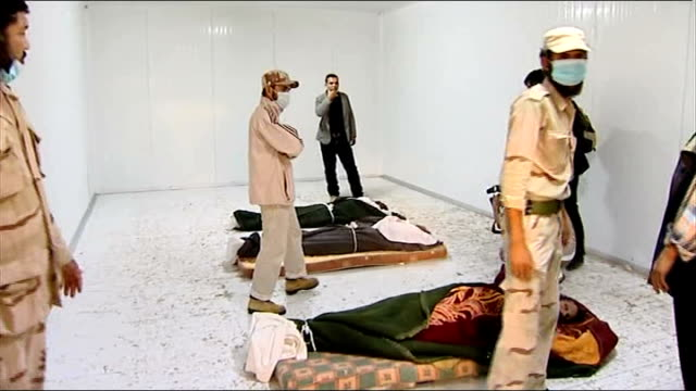 National Transitional Council holds liberation ceremony in Benghazi Misrata INT Men standing around dead bodies of Colonel Gaddafi Moatassem Gaddafi...