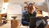 Native American artist using laptop in his art studio