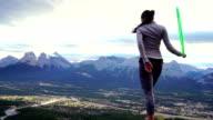 Native American hoop dancer performs on mountain summit