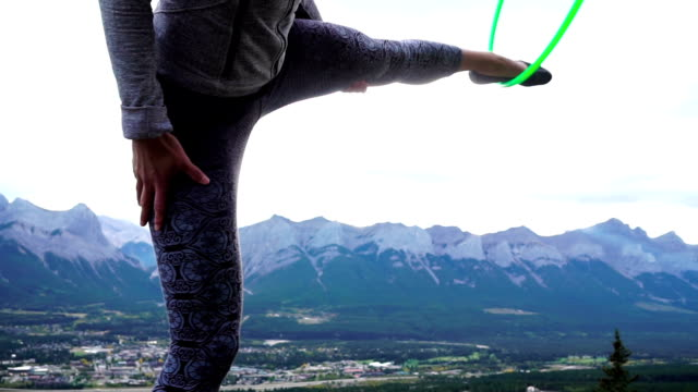 Native American hoop dancer performs on mountain summit