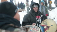 Native Americans from Washington state drum and sing as they wait for the arrival at Oceti Sakowin Camp of native American activists traveling from...