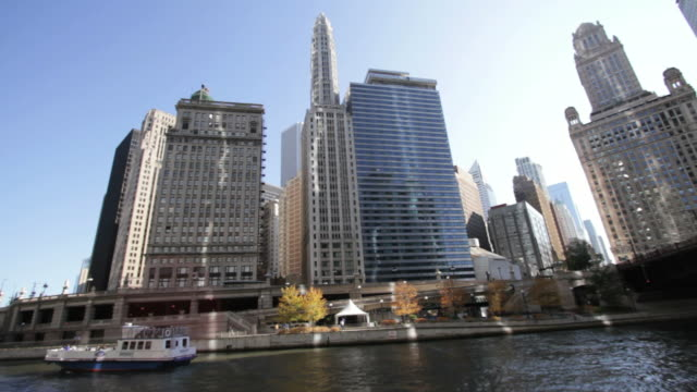 Nautical vessel in river and skyline downtown Chicago USA