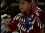 Navajo girl performs traditional native dance in traditional clothes North America