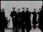 Naval Officers saluting each other on a ship / Sailors at attention for inspection /