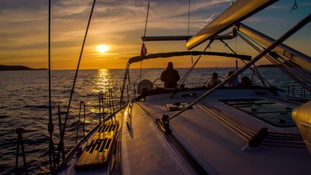 WS Navigating A Sailboat At Dusk
