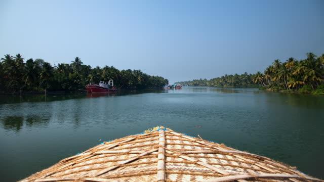 T/L POV Navigating backwaters of Kerala in houseboat / Kollam, Kerala, India