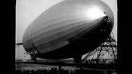 US Navy airship AKRON taking off crashing rudder into ground / damaged rudder seen in closer shot crowds surrounding ship US Navy airship Akron on...