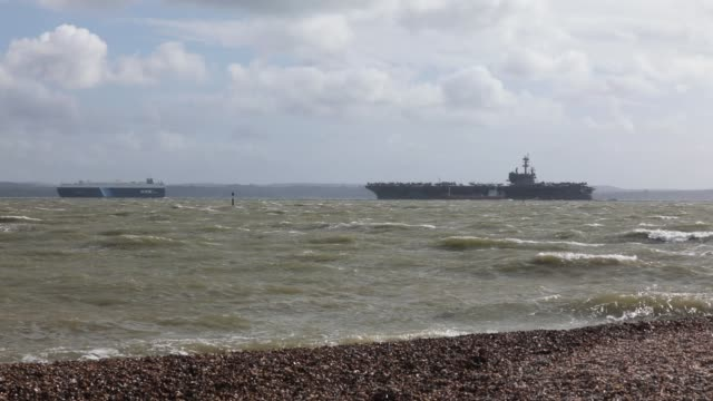 US Navy Nimitzclass aircraft carrier USS George HW Bush is pictured anchored off the coast on July 27 2017 in Portsmouth England