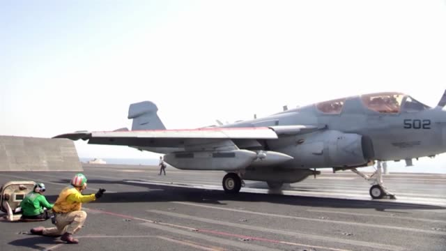 US Navy Sailors direct aircraft during flight deck operations aboard the aircraft carrier USS George HW Bush Bush is operating in the Arabian Gulf on...