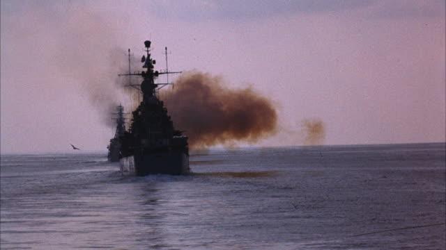 MS Navy ships guns firing in sky