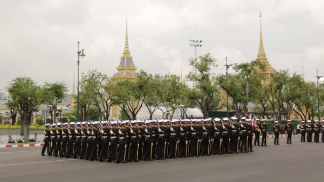 Navy soldiers walk in formation during the cremation procession for the late King Bhumibol Adulyadej at Sanam Luang ceremonial ground in Bangkok...