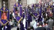 Nazarenos in a procession during Holy Week, Semana Santa, April 2011, Malaga, Spain, Europe