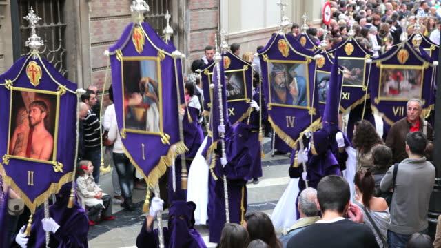 Nazarenos in a procession during Holy Week, Semana Santa, April 2011, Malaga, Spain, Europe