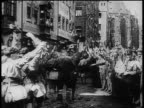 Nazis giving fascist salute as they march at rally at Nuremberg / newsreel