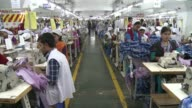 Nearly 40 percent of garment factories in the Bangladesh capital were failing to pay a new minimum wage announced last year for workers stitching...