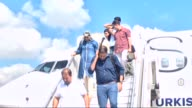 Necdet Yilmaz and Ercan Ozpilavci two of Turkish workers kidnapped in Iraq arrive at the airport in Istanbul Turkey on September 17 2015 after being...